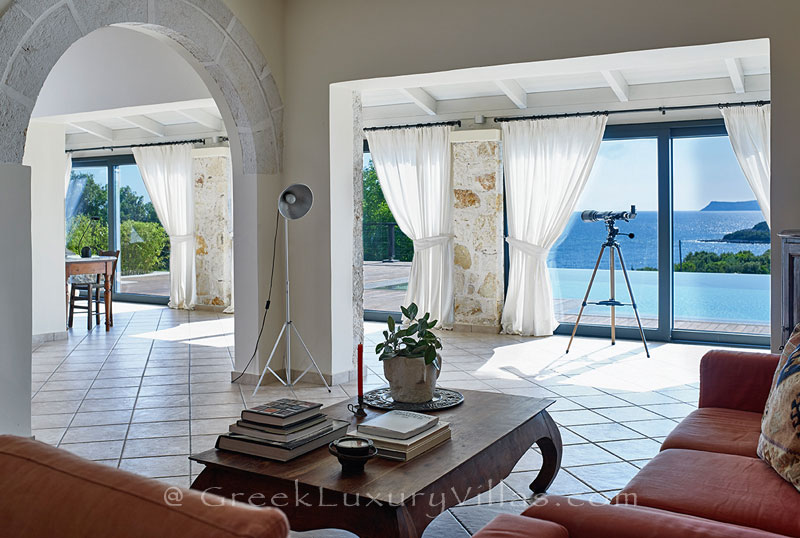 The seaview from the living-room of a luxury villa with a heated pool