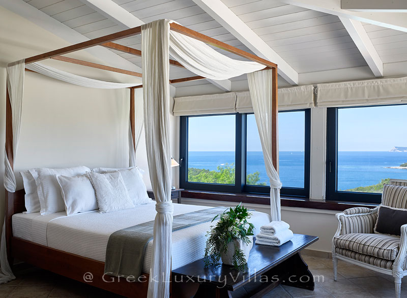 The view of the sea from the bed of a luxury villa with a heated pool in Sivota
