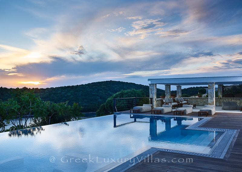 The sunset from a luxury villa with a heated pool in Sivota