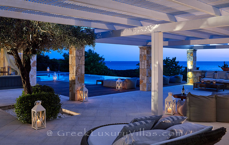 The outdoor lounge of the luxury villa with a heated pool in Sivota