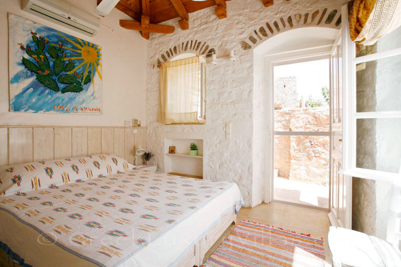 The bedroom in a romantic traditional house in Hydra