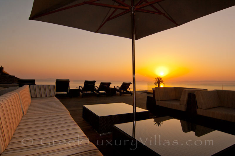 Sunset by the pool lounge of luxury villa in Kea