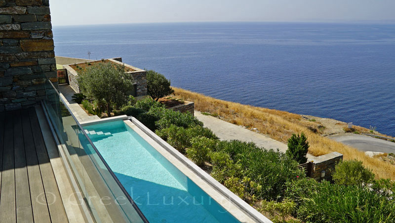 Lap pool of big luxury villa with by the beach in Kea