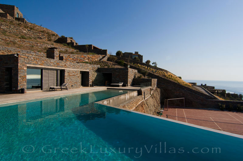 Pool and tennis court of big luxury villa by the beach on Kea