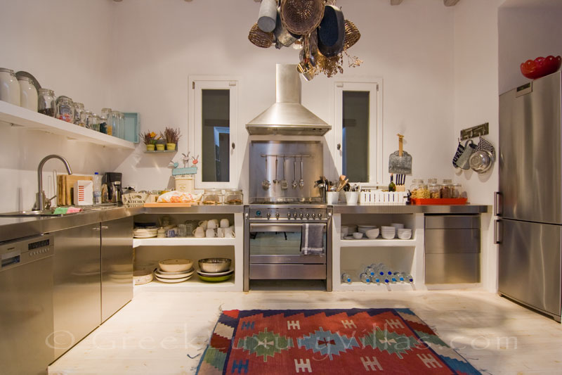 The kitchen in a luxurious villa with a big pool on Kea