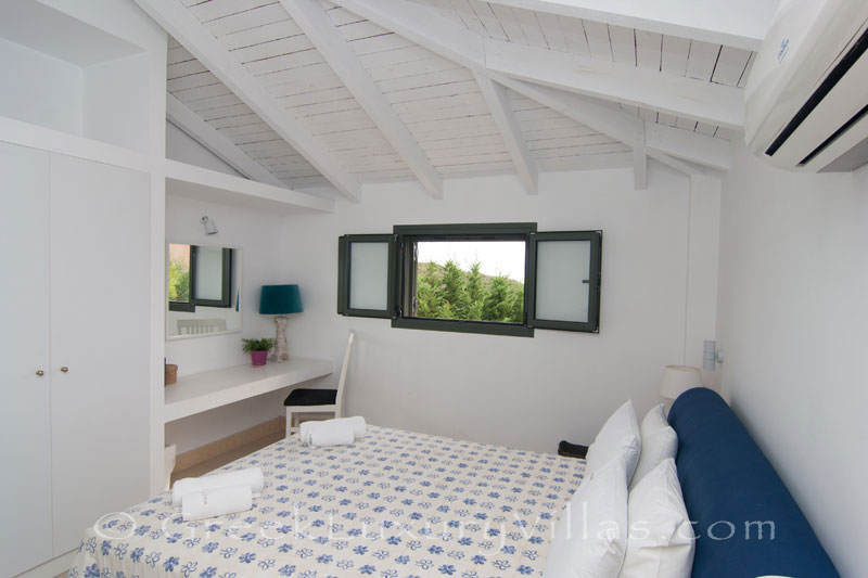 A bedroom of a modern, two bedroom villa with a private pool in Kefalonia