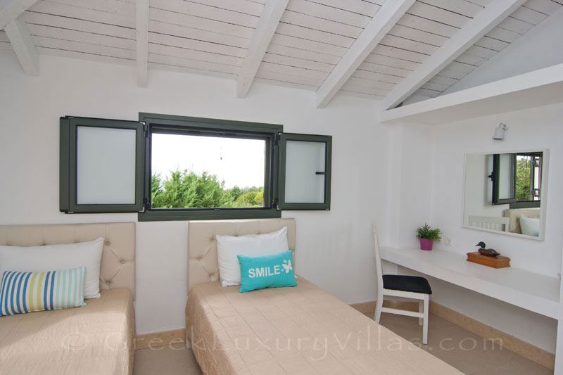 A bedroom of the modern, two bedroom villa with a private pool in Kefalonia