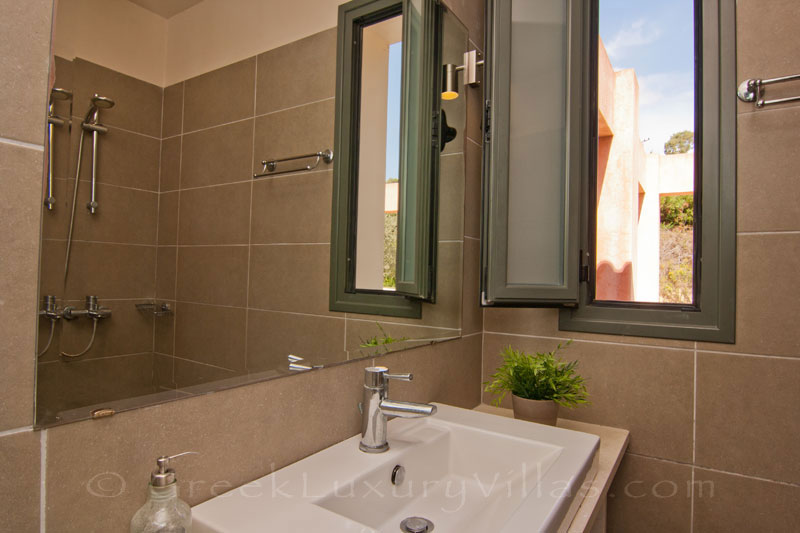 A bathroom in the modern, three bedroom villa near the beach in Kefalonia