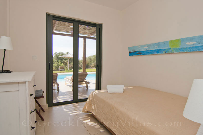 A bedroom in the modern, three bedroom villa near the beach in Kefalonia