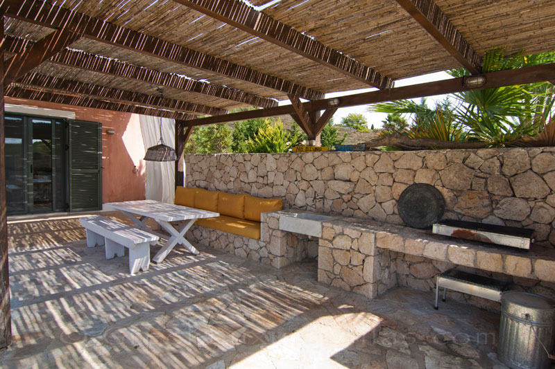 The BBQ area of a modern, three-bedroom villa with a pool in Kefalonia