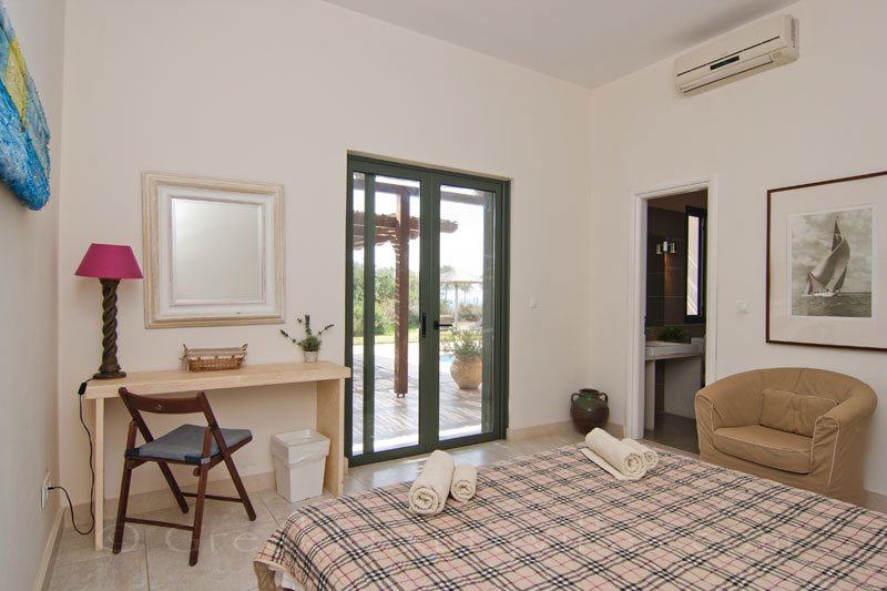 A bedroom in a modern, three bedroom villa near the beach in Kefalonia