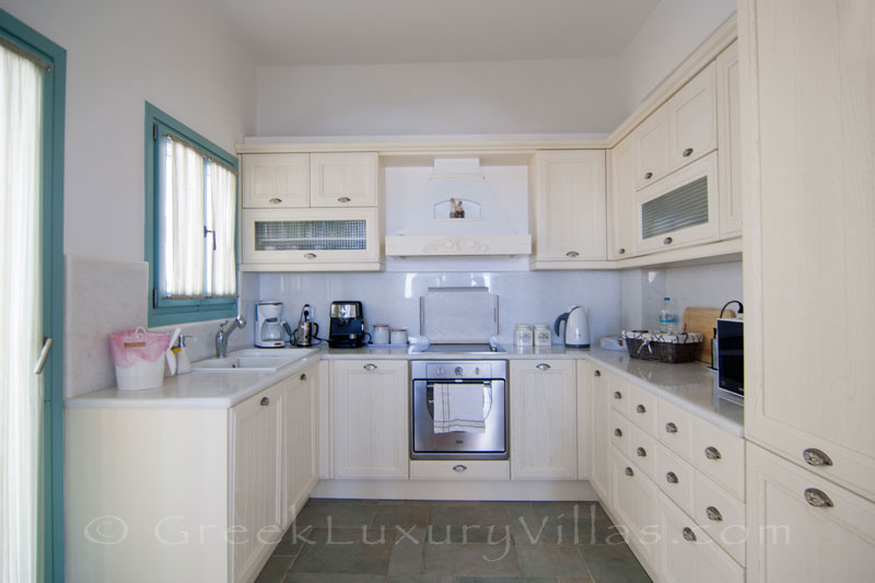 Fully equipped kitchen of luxury villa with pool on Koufonisi