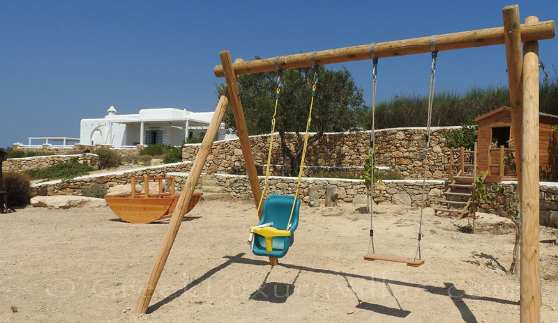 Private playground of luxury villa with pool in Koufonisi