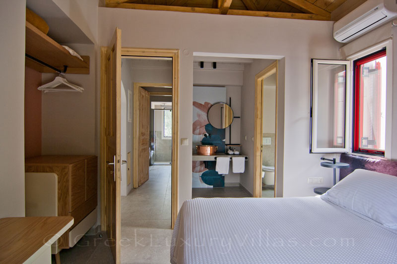 Modern bedrooms of the luxurious villa in Lefkas