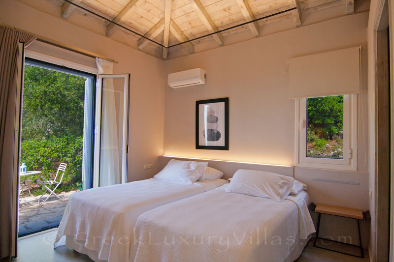 Modern villa bedroom with garden access in Lefkas