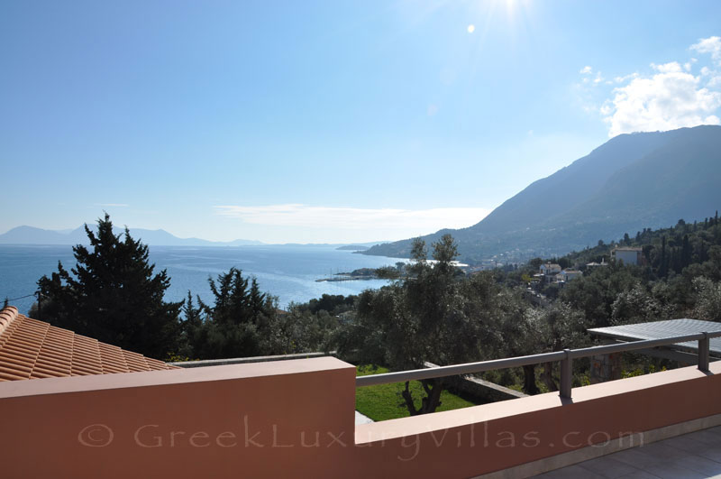 The seaview from the veranda of a modern luxury villa with a pool in Lefkas