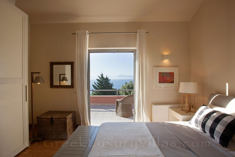 The seaview from a bedroom of a modern luxury villa with a pool in Lefkada