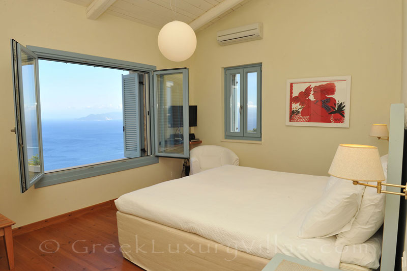 A bedroom in a luxury villa with a pool in Lefkas that sleeps six people