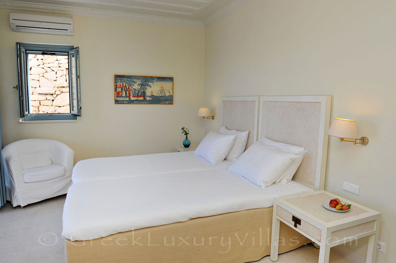 A bedroom in the luxury villa with a pool in Lefkas that sleeps six people