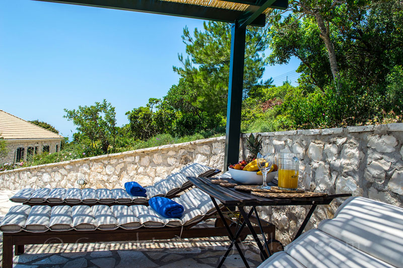 Relaxing by the pool in traditional villa on Lefkas