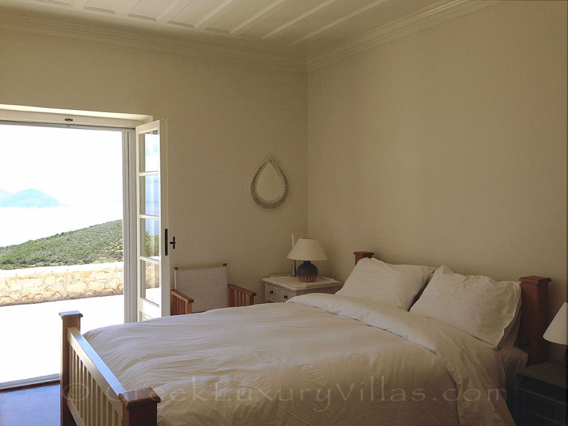 Bedroom of traditional villa with stunning garden views and pool on Lefkas