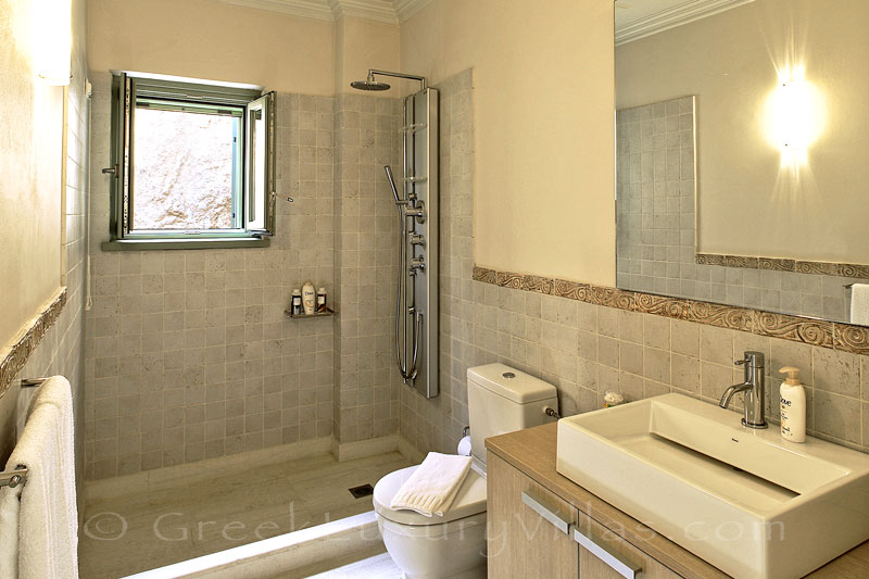 A bathroom in the luxury villa with a pool in Lefkas