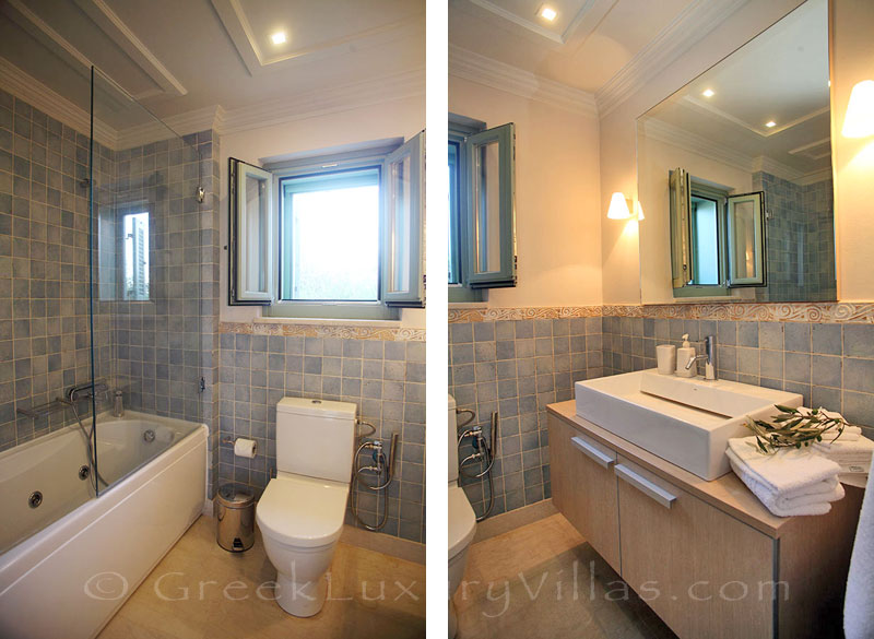 A luxurious bathroom in a villa with a pool in Lefkada