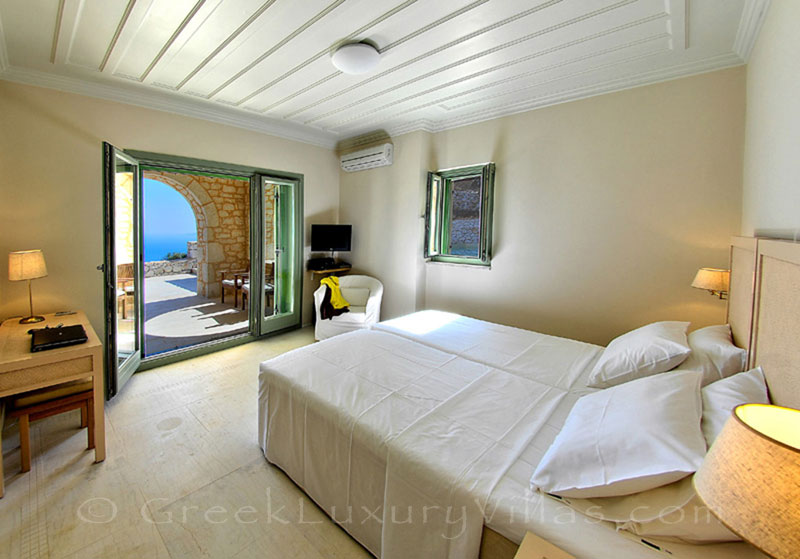 A bedroom in the luxurious villa with a pool and seaview in Lefkaka