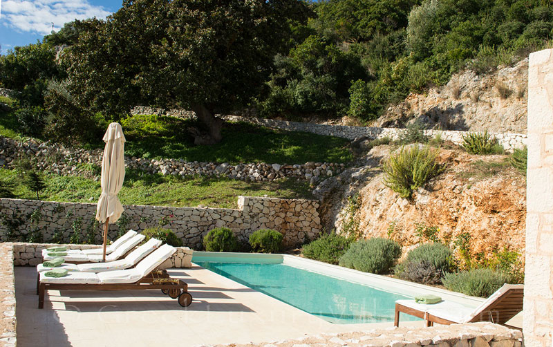 A luxury villa with a pool in Lefkada surrounded by nature