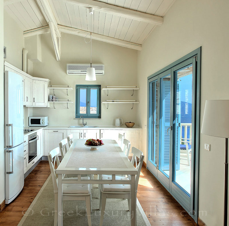 The kitchen of a villa with seaview and a pool in Lefkas