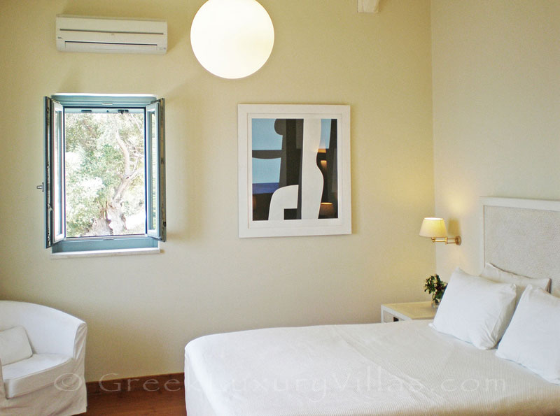 A bedroom with seaview in a villa with view of the sea and a pool in Lefkas
