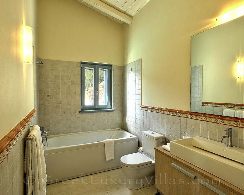 A bathroom in the villa with seaview and a pool in Lefkas