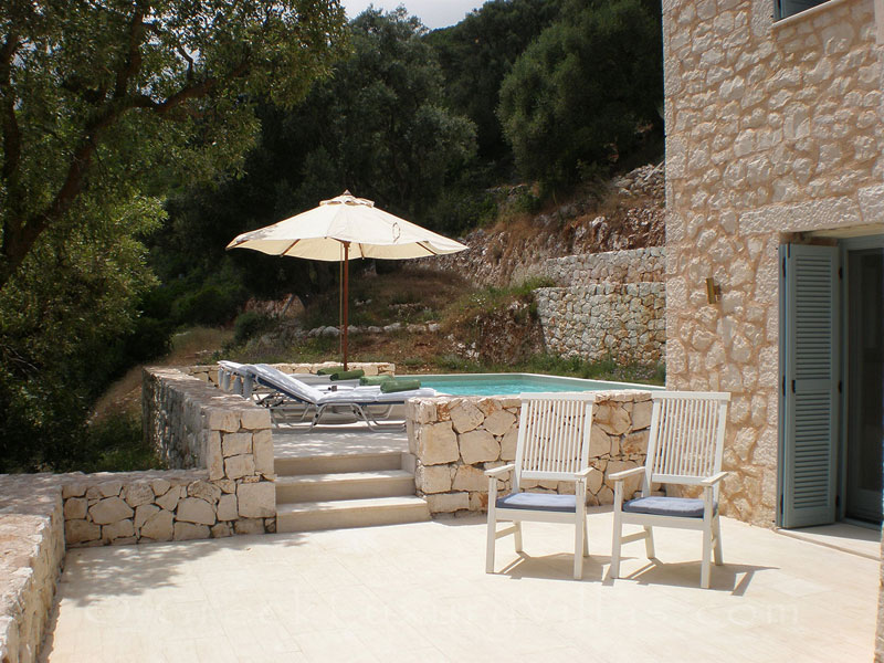 A terrace of a villa with seaview and a pool in Lefkada