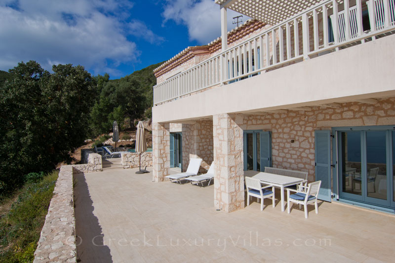 The terrace of a bedroom of a villa with sea view and a pool in Lefkada