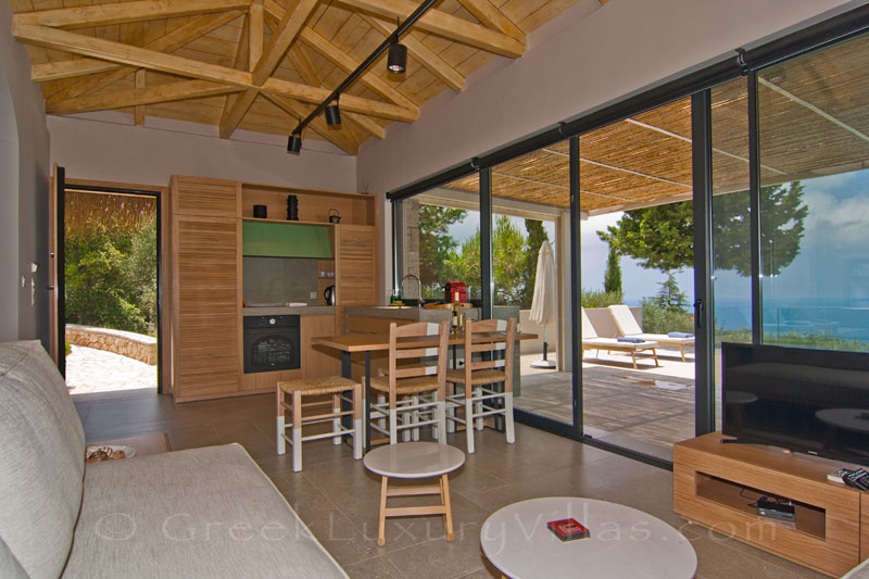Open plan kitchen in villa with pool and seaview