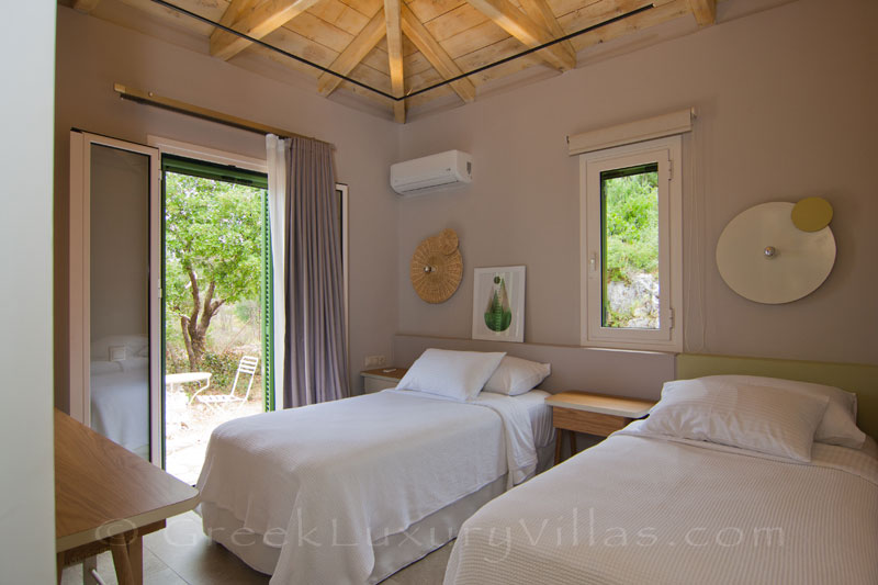 Bedroom with two single beds in modern villa on Lefkas