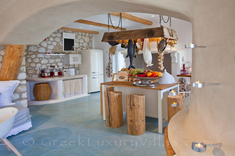 A stylish open plan kitchen of a luxury villa with a pool in Naxos