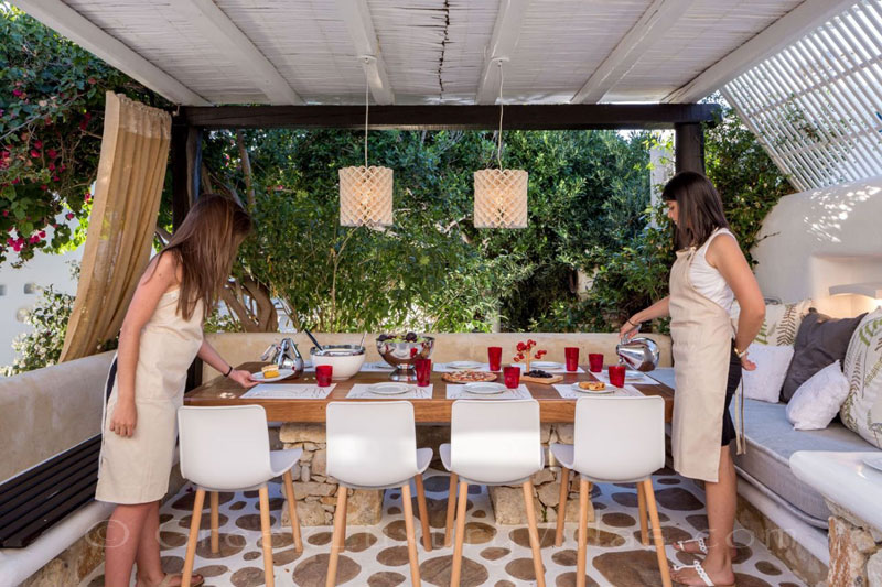 Breakfast service at a luxury villa with a pool in Naxos