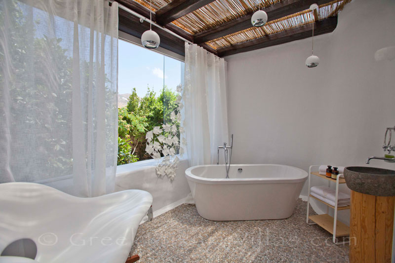 A romantic bathroom of a luxury villa with a pool in Naxos