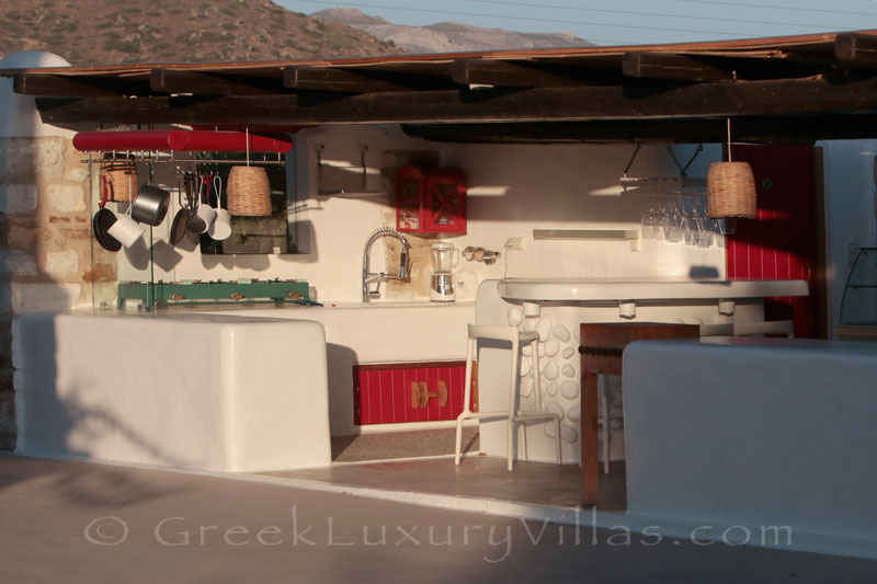 An outdoor kitchen at a luxury villa with a pool in Naxos