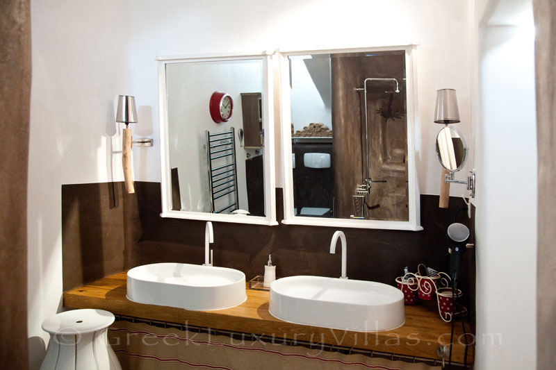 A luxurious bathroom of a luxury villa with a pool in Naxos