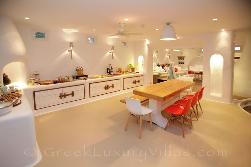 A professional kitchen and dining area in a luxury villa with a pool in Naxos