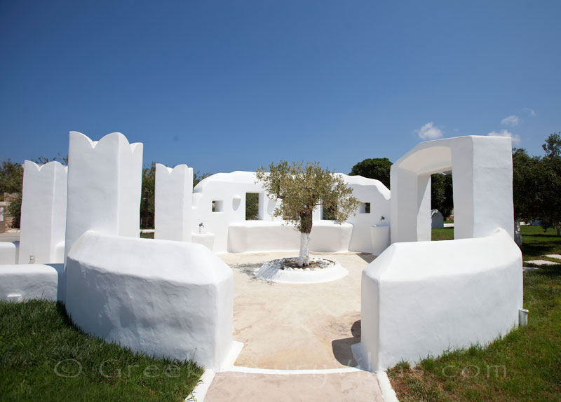 A picturesque garden of a luxury villa with a pool in Naxos