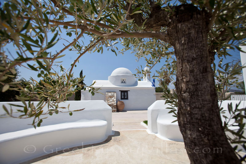 The chapel in the garden of a luxury villa with a pool in Naxos