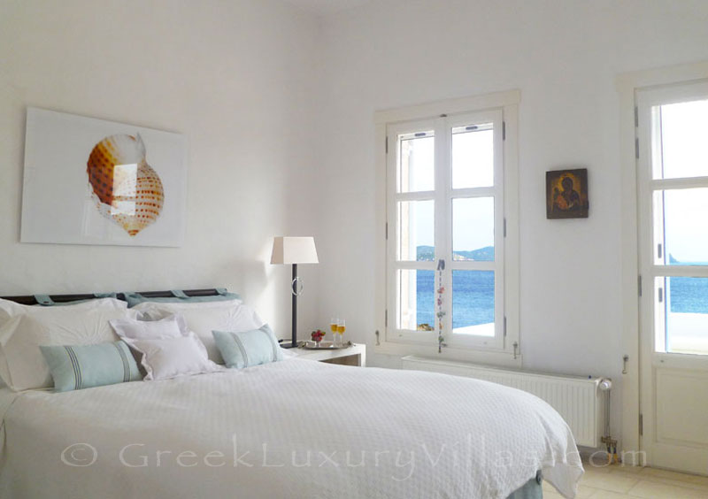 The bedroom of a beachfront villa in Patmos
