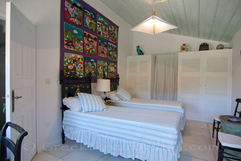 A bedroom in a beachfront villa in Paxos