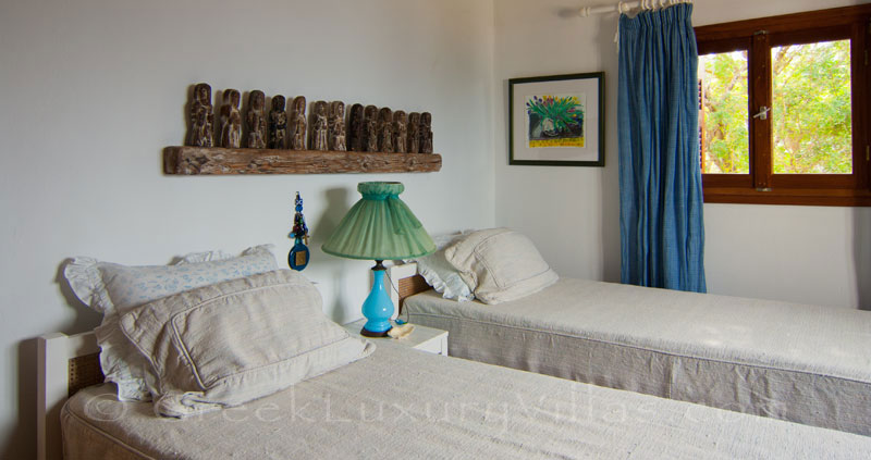 A bedroom with seaview in a beachfront villa in Paxos