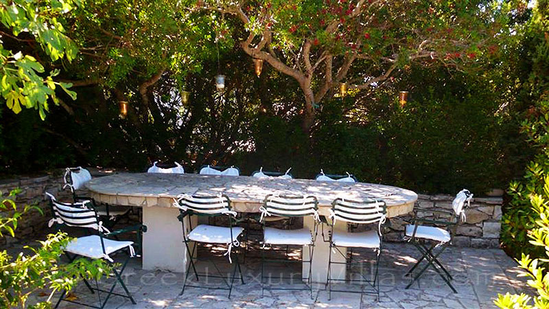 A dining table in the garden of the beachfront villa in Paxos