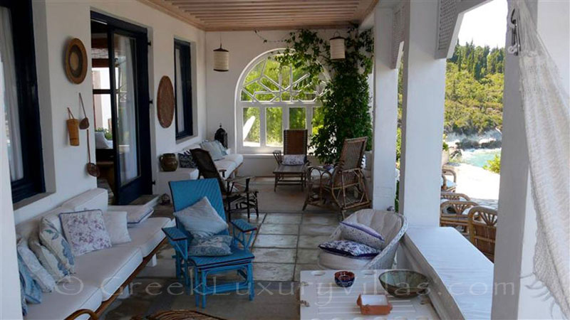 The veranda of a beachfront villa in Paxos