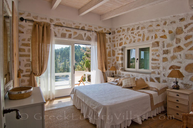 A bedroom in the seafront luxury villa in Paxos